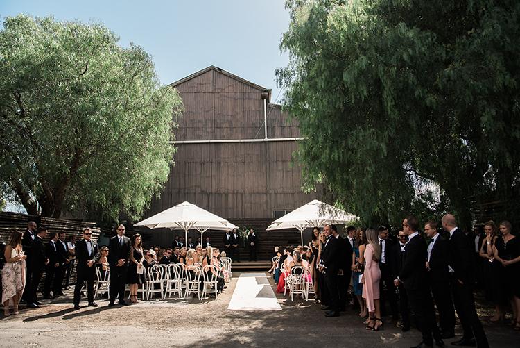 black tie Australian weddings - photo by Jerome Cole http://ruffledblog.com/fun-black-tie-warehouse-wedding-in-melbourne