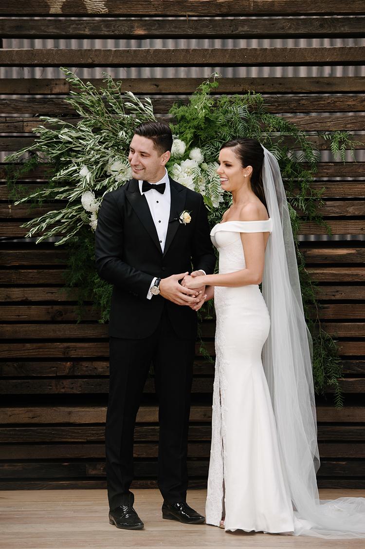 wedding ceremonies with greenery - photo by Jerome Cole https://ruffledblog.com/fun-black-tie-warehouse-wedding-in-melbourne
