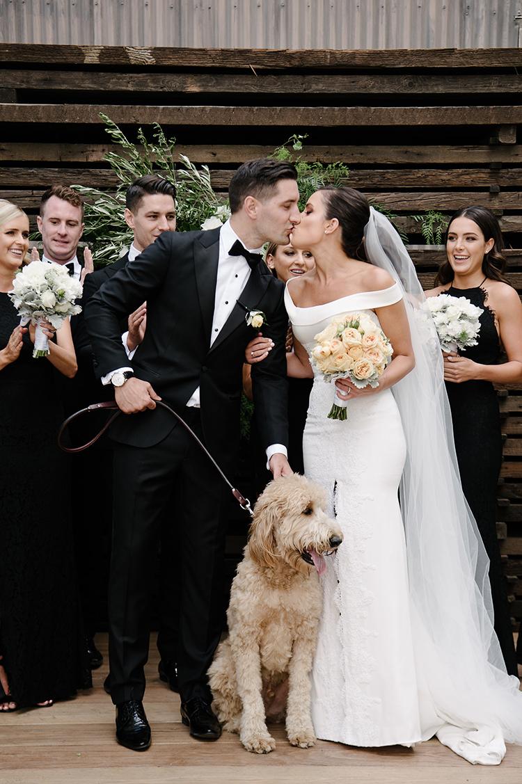 ceremony kiss - photo by Jerome Cole http://ruffledblog.com/fun-black-tie-warehouse-wedding-in-melbourne