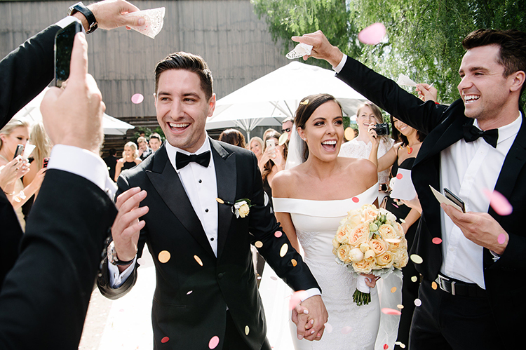 ceremony recessionals with petals - photo by Jerome Cole https://ruffledblog.com/fun-black-tie-warehouse-wedding-in-melbourne