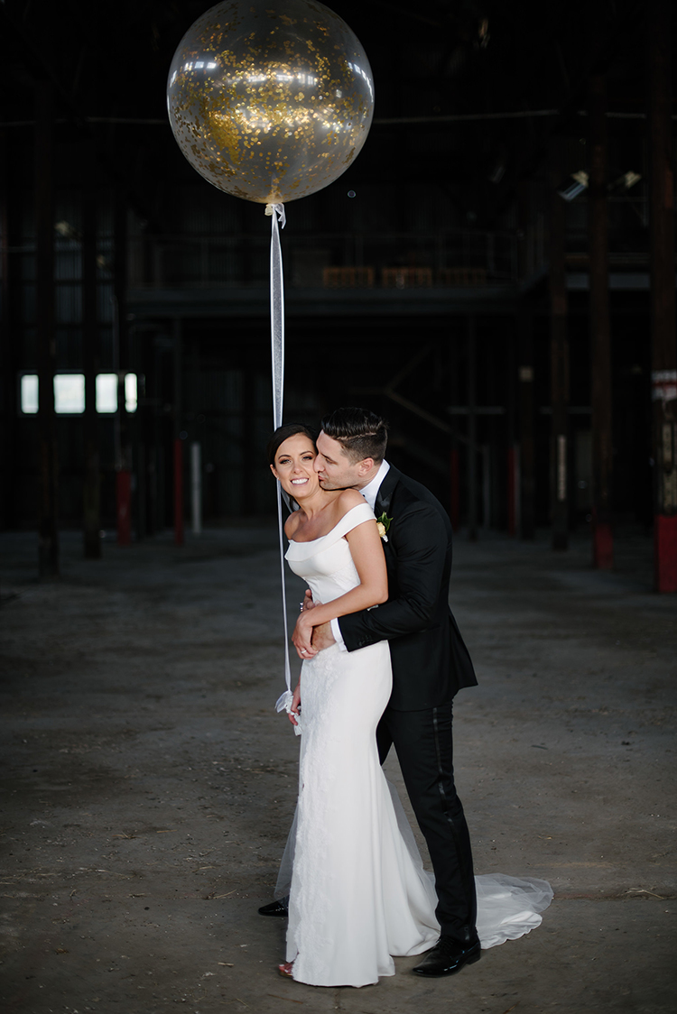 wedding portraits with balloons - photo by Jerome Cole https://ruffledblog.com/fun-black-tie-warehouse-wedding-in-melbourne