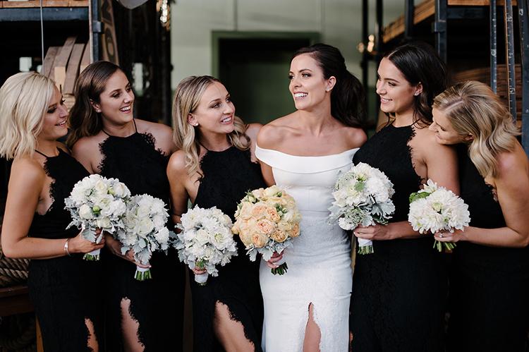 black tie bridesmaid dresses - photo by Jerome Cole http://ruffledblog.com/fun-black-tie-warehouse-wedding-in-melbourne