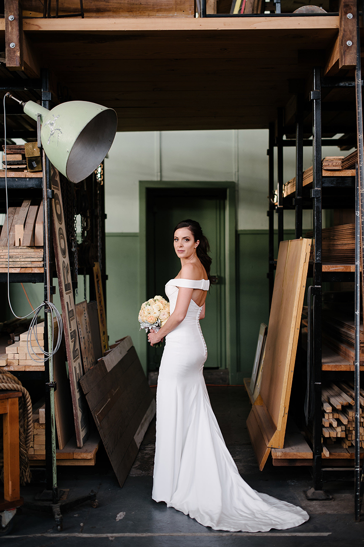 chic bridal gowns - photo by Jerome Cole http://ruffledblog.com/fun-black-tie-warehouse-wedding-in-melbourne