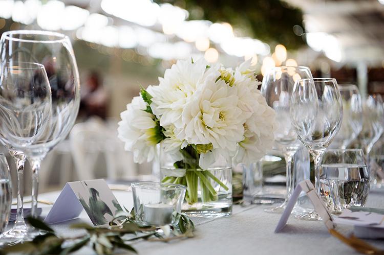 ivory dahlia centerpieces - photo by Jerome Cole http://ruffledblog.com/fun-black-tie-warehouse-wedding-in-melbourne