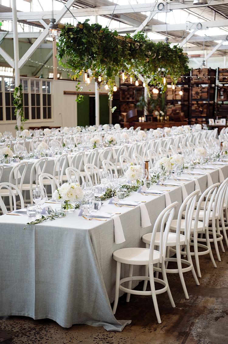 black tie weddings with greenery - photo by Jerome Cole http://ruffledblog.com/fun-black-tie-warehouse-wedding-in-melbourne