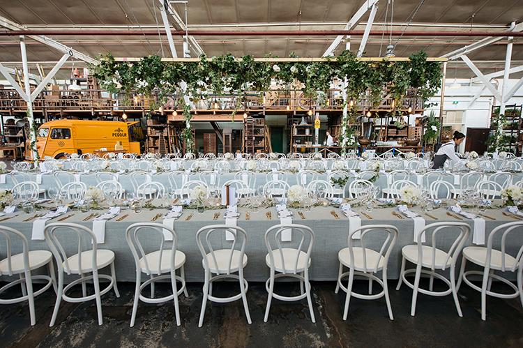 industrial weddings - photo by Jerome Cole https://ruffledblog.com/fun-black-tie-warehouse-wedding-in-melbourne
