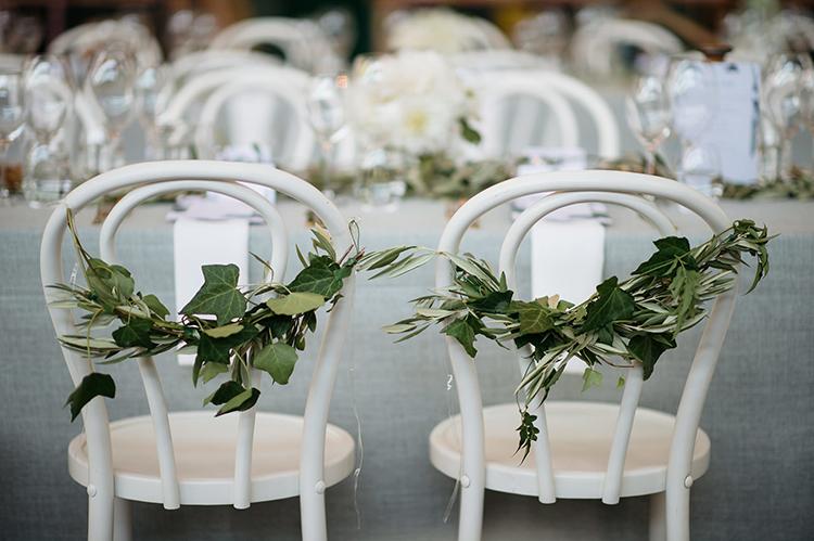 wedding chair greenery - photo by Jerome Cole https://ruffledblog.com/fun-black-tie-warehouse-wedding-in-melbourne