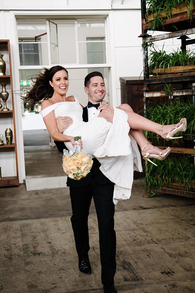 bride and groom - photo by Jerome Cole https://ruffledblog.com/fun-black-tie-warehouse-wedding-in-melbourne