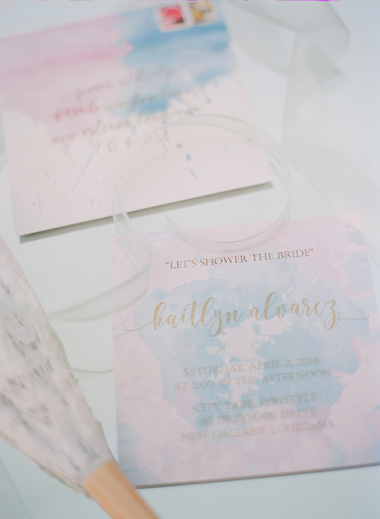 watercolor shower invitations - photo by Arte de Vie http://ruffledblog.com/garden-bridal-shower-with-hanging-umbrellas