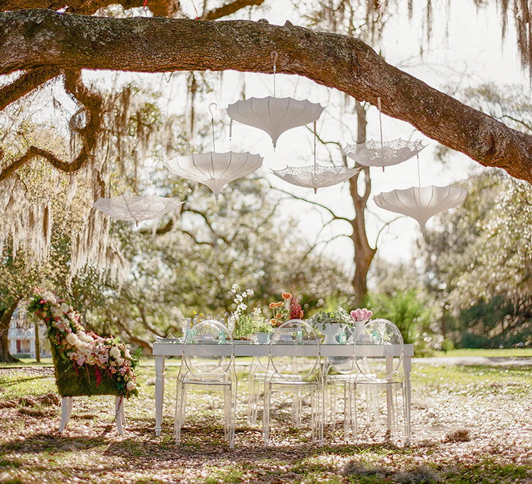 garden wedding showers - photo by Arte de Vie http://ruffledblog.com/garden-bridal-shower-with-hanging-umbrellas