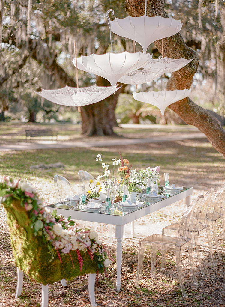 wedding tables with hanging umbrellas - photo by Arte de Vie http://ruffledblog.com/garden-bridal-shower-with-hanging-umbrellas