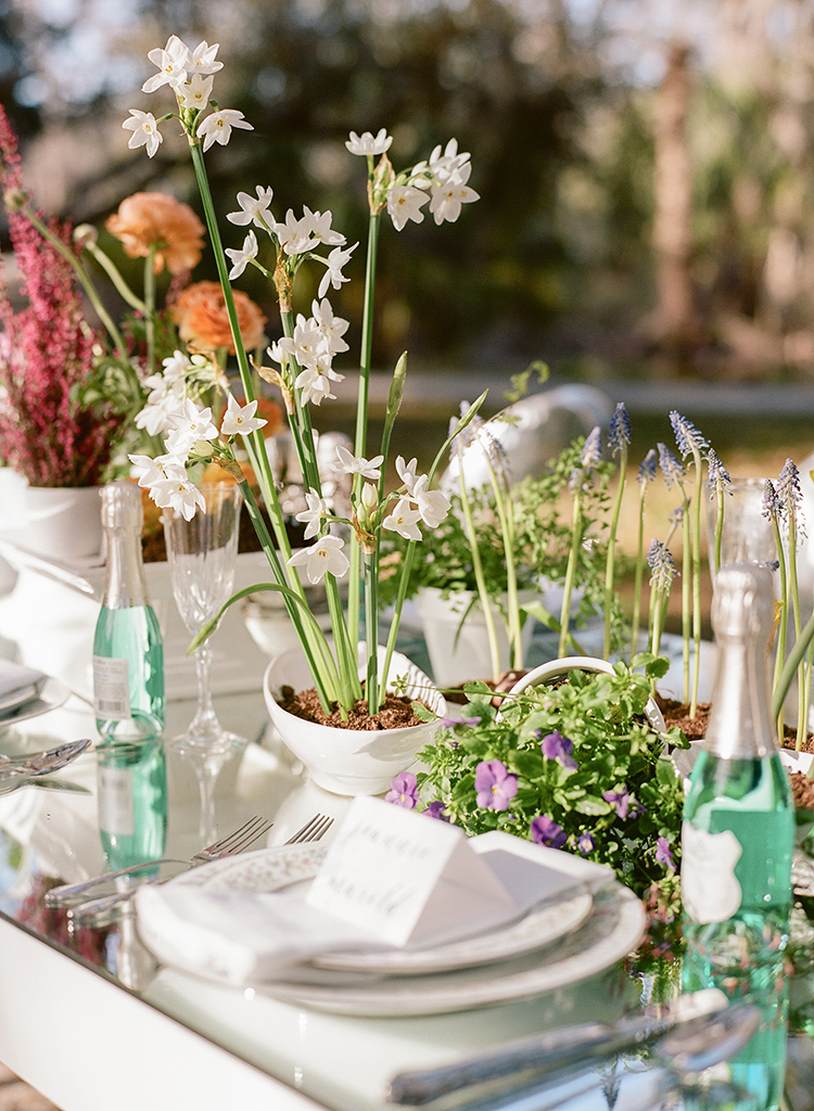 garden wedding centerpieces - photo by Arte de Vie http://ruffledblog.com/garden-bridal-shower-with-hanging-umbrellas