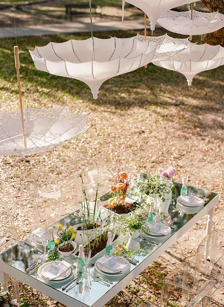 hanging umbrella decor - photo by Arte de Vie http://ruffledblog.com/garden-bridal-shower-with-hanging-umbrellas
