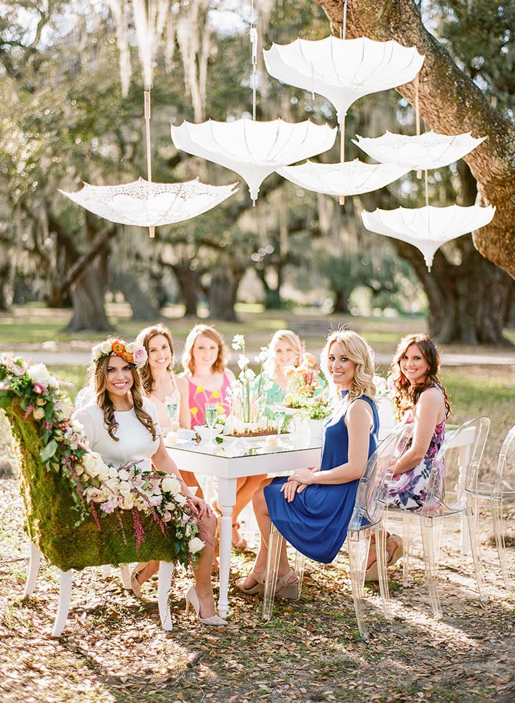 This April Bridal Shower Brings a May Wedding - photo by Arte de Vie http://ruffledblog.com/garden-bridal-shower-with-hanging-umbrellas