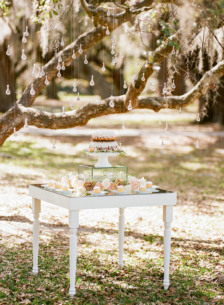 wedding cake tables - photo by Arte de Vie http://ruffledblog.com/garden-bridal-shower-with-hanging-umbrellas