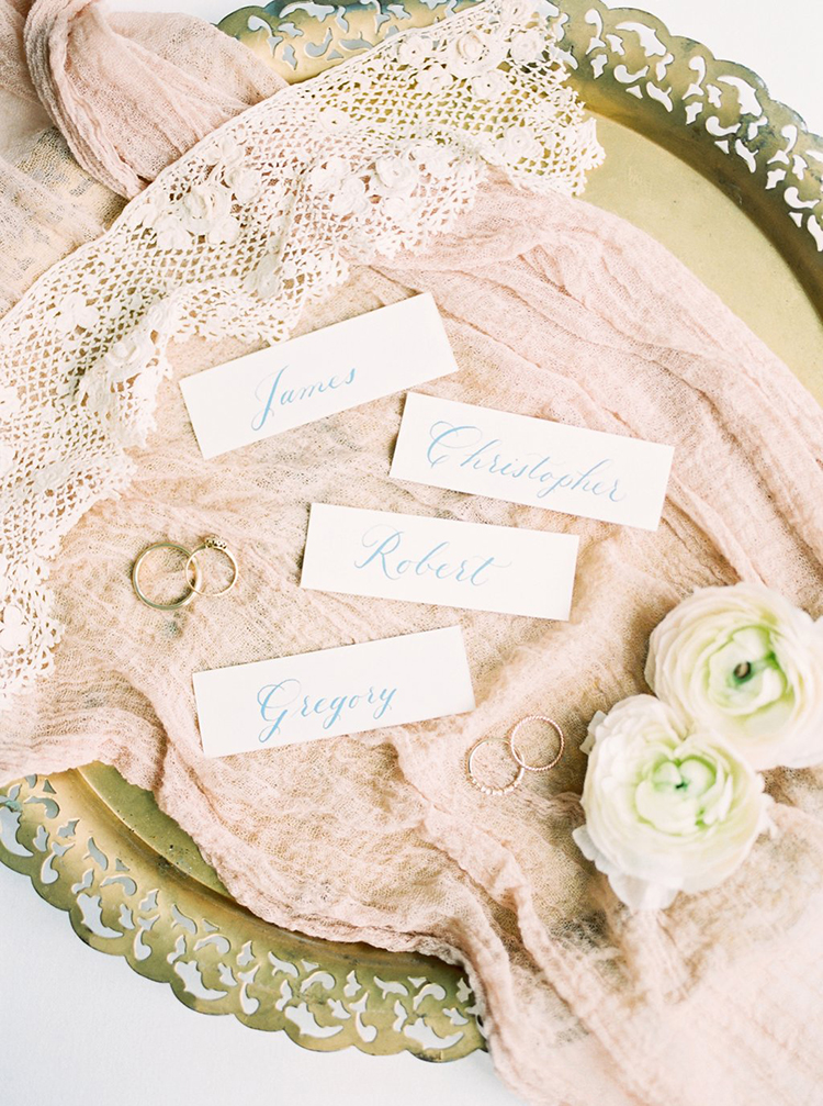 paper place cards - photo by Hillary Muelleck Photography http://ruffledblog.com/garden-estate-wedding-inspiration-with-delicate-poppies