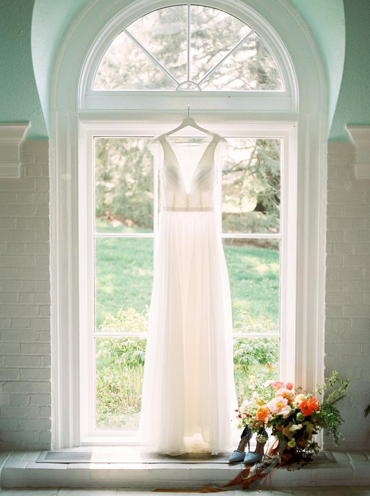 cap sleeve wedding dresses - photo by Hillary Muelleck Photography http://ruffledblog.com/garden-estate-wedding-inspiration-with-delicate-poppies