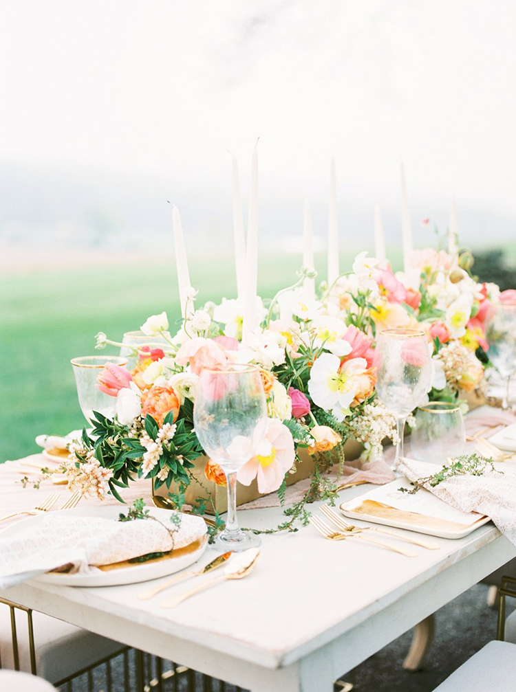 romantic floral centerpieces - photo by Hillary Muelleck Photography http://ruffledblog.com/garden-estate-wedding-inspiration-with-delicate-poppies