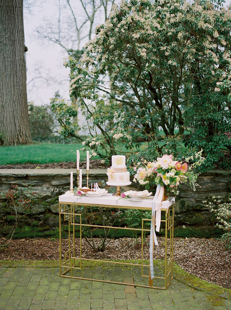 wedding cake tables - photo by Hillary Muelleck Photography http://ruffledblog.com/garden-estate-wedding-inspiration-with-delicate-poppies