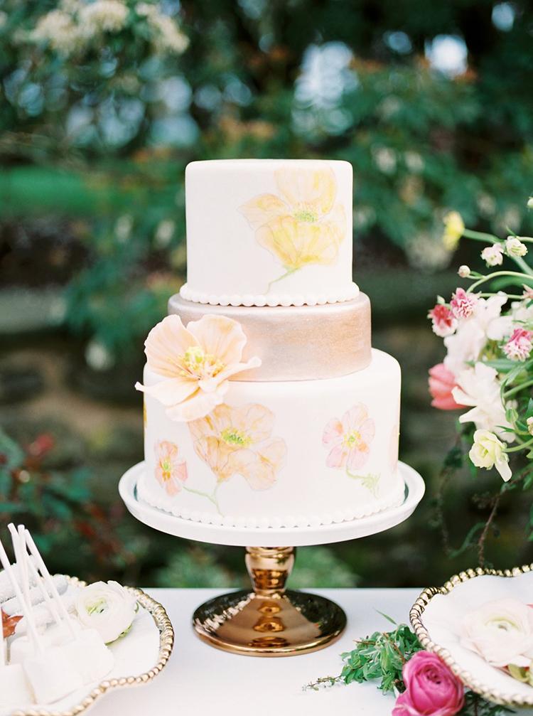 poppy wedding cakes - photo by Hillary Muelleck Photography http://ruffledblog.com/garden-estate-wedding-inspiration-with-delicate-poppies