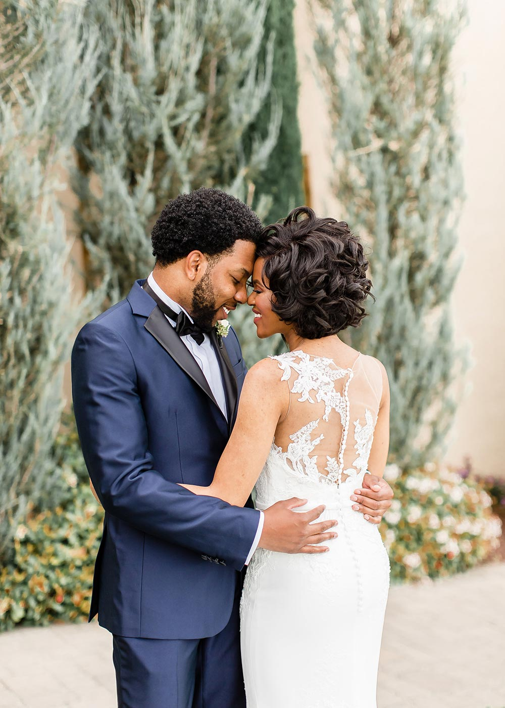 illusion back wedding dress and navy blue groom suit