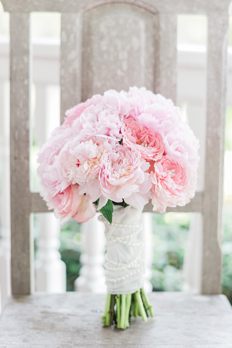 pink peony bouquets - photo by A.J. Dunlap Photography http://ruffledblog.com/glamorous-seaside-soiree-wedding-with-glam-details