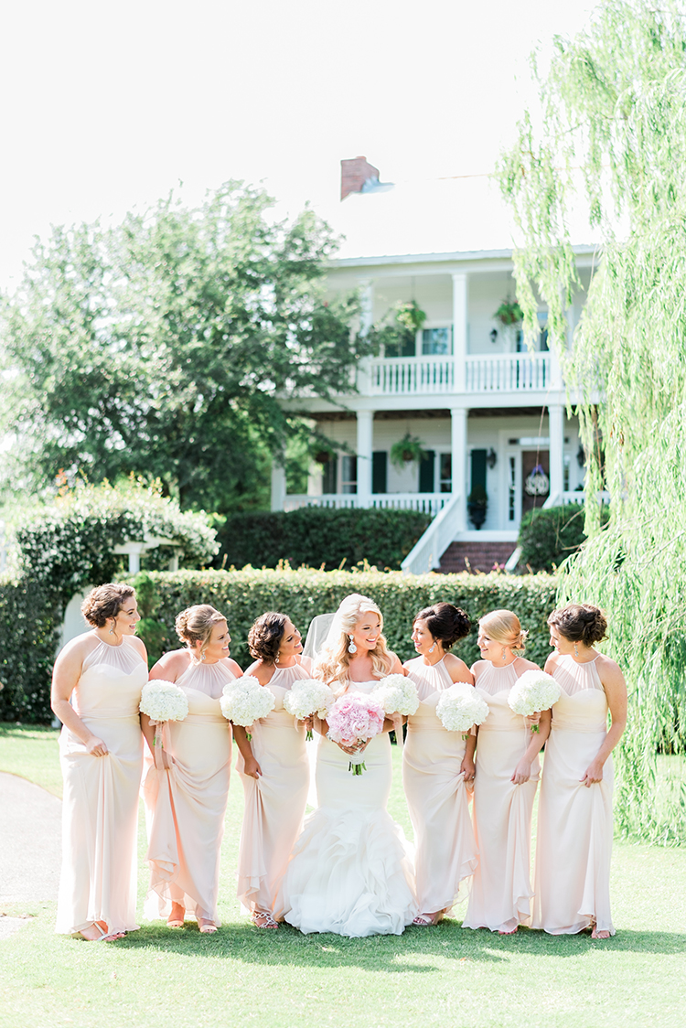 blush pink bridesmaid dresses - photo by A.J. Dunlap Photography http://ruffledblog.com/glamorous-seaside-soiree-wedding-with-glam-details