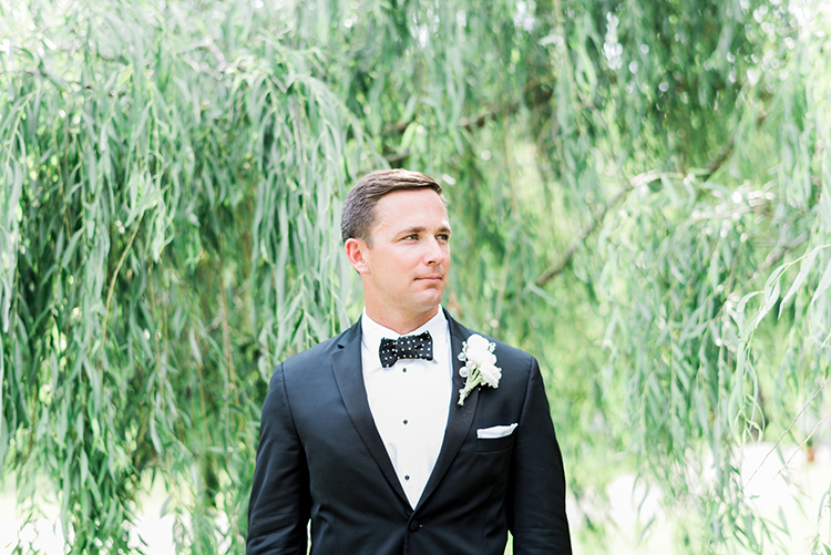 classic groom style - photo by A.J. Dunlap Photography http://ruffledblog.com/glamorous-seaside-soiree-wedding-with-glam-details