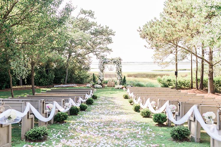 North Carolina waterside weddings - photo by A.J. Dunlap Photography https://ruffledblog.com/glamorous-seaside-soiree-wedding-with-glam-details