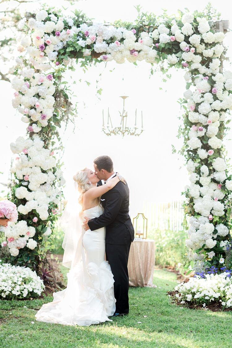 floral ceremony arches - photo by A.J. Dunlap Photography http://ruffledblog.com/glamorous-seaside-soiree-wedding-with-glam-details