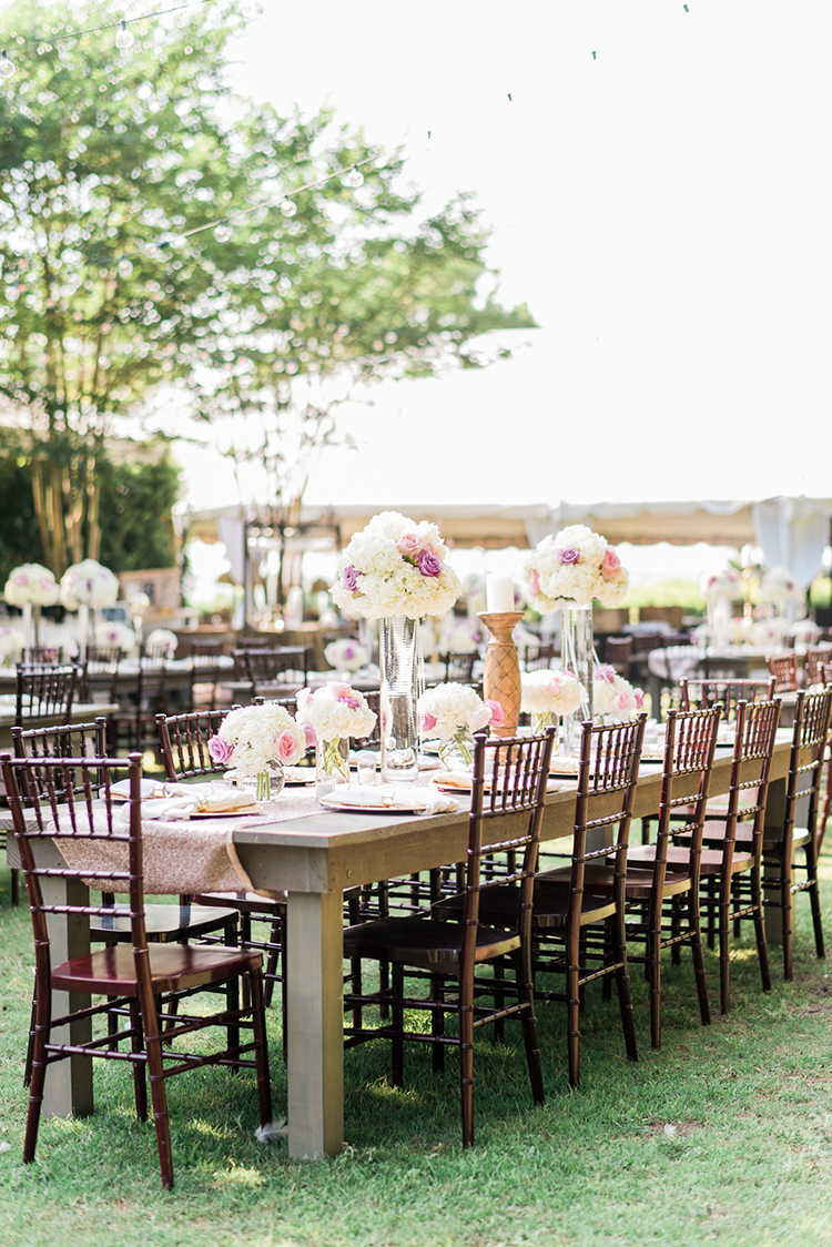 outdoor wedding reception tables - photo by A.J. Dunlap Photography http://ruffledblog.com/glamorous-seaside-soiree-wedding-with-glam-details