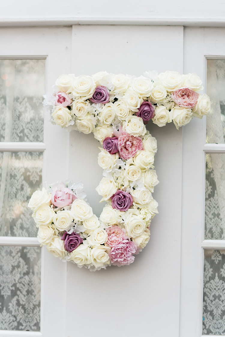 floral wedding monograms - photo by A.J. Dunlap Photography http://ruffledblog.com/glamorous-seaside-soiree-wedding-with-glam-details