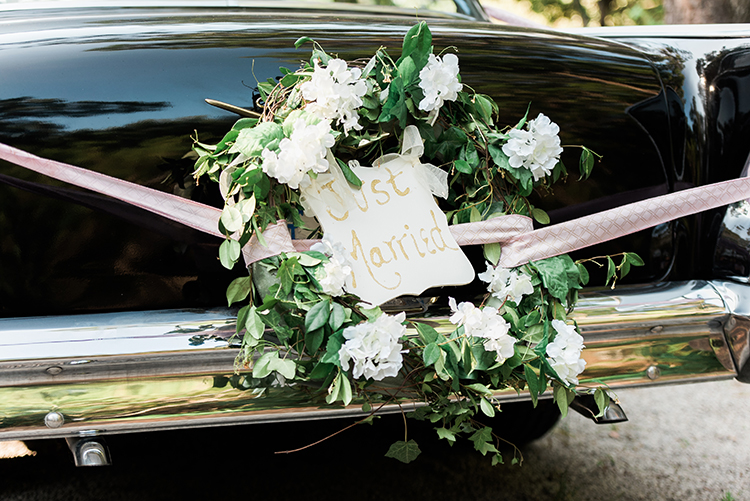 just married car signs - photo by A.J. Dunlap Photography http://ruffledblog.com/glamorous-seaside-soiree-wedding-with-glam-details