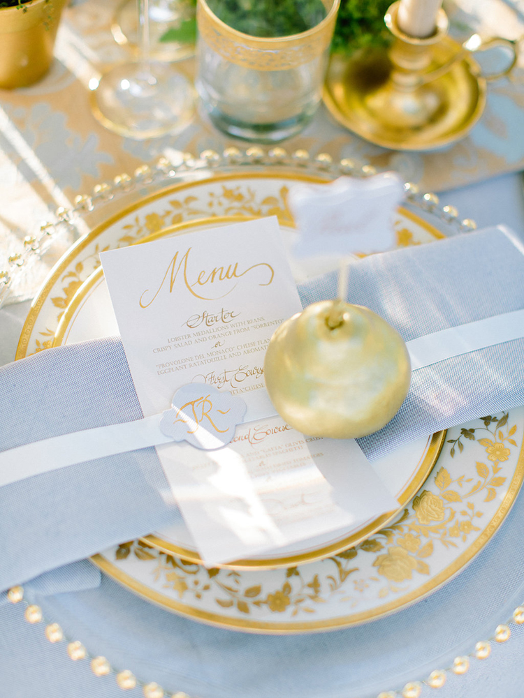 gold and blue place settings - photo by Facibeni Fotografia http://ruffledblog.com/golden-sunset-wedding-inspiration-overlooking-tuscan-hills