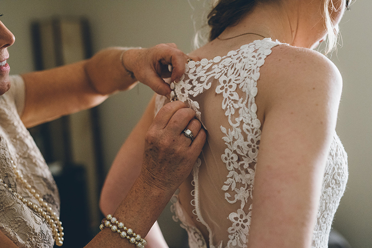 bride getting ready - photo by Ed and Aileen Photography https://ruffledblog.com/handcrafted-wedding-with-a-doily-hoop-ceremony-backdrop
