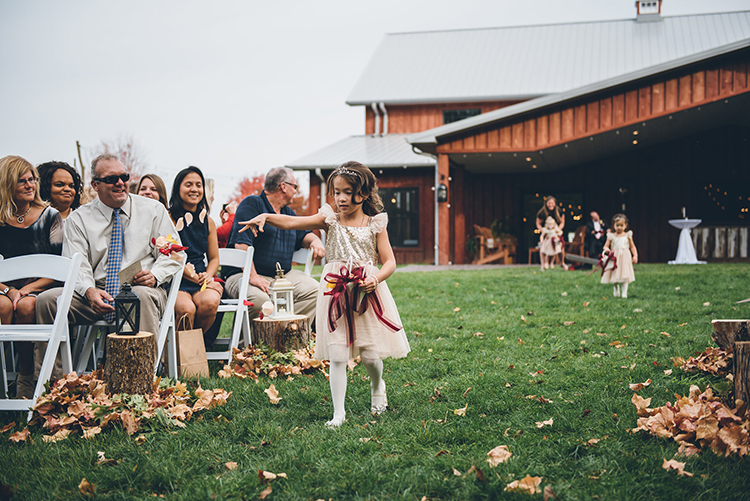 flower girl processionals - photo by Ed and Aileen Photography https://ruffledblog.com/handcrafted-wedding-with-a-doily-hoop-ceremony-backdrop