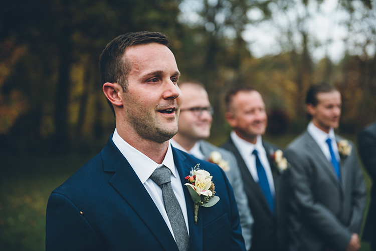 groom reaction during ceremony - photo by Ed and Aileen Photography https://ruffledblog.com/handcrafted-wedding-with-a-doily-hoop-ceremony-backdrop