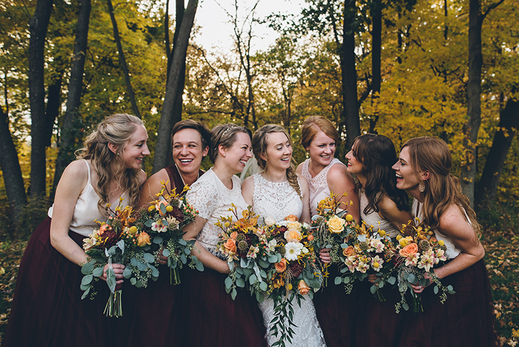 bridesmaid bouquets with yellow blooms - photo by Ed and Aileen Photography https://ruffledblog.com/handcrafted-wedding-with-a-doily-hoop-ceremony-backdrop