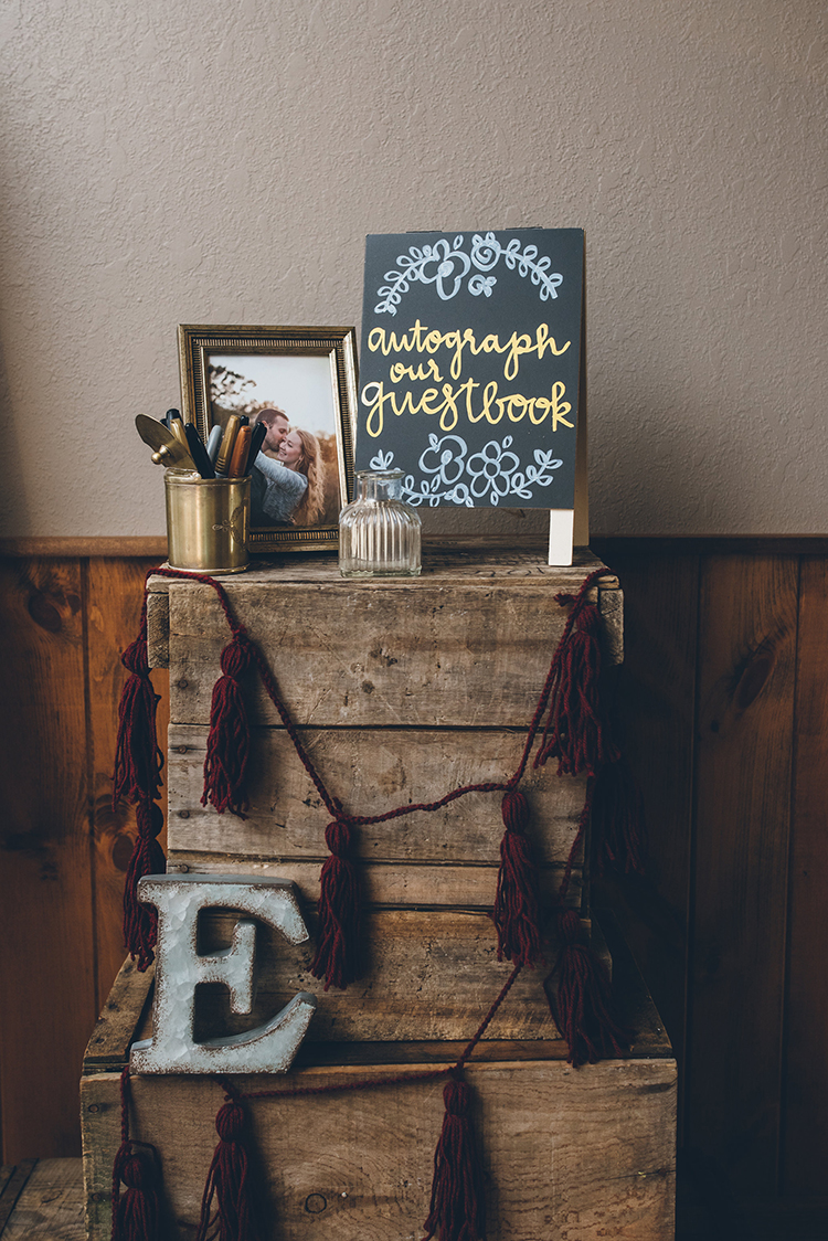 wedding guest books - photo by Ed and Aileen Photography https://ruffledblog.com/handcrafted-wedding-with-a-doily-hoop-ceremony-backdrop
