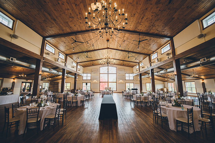 rustic wedding receptions - photo by Ed and Aileen Photography https://ruffledblog.com/handcrafted-wedding-with-a-doily-hoop-ceremony-backdrop