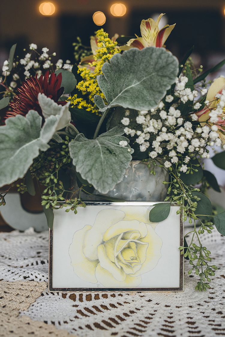 yellow rose centerpieces - photo by Ed and Aileen Photography https://ruffledblog.com/handcrafted-wedding-with-a-doily-hoop-ceremony-backdrop