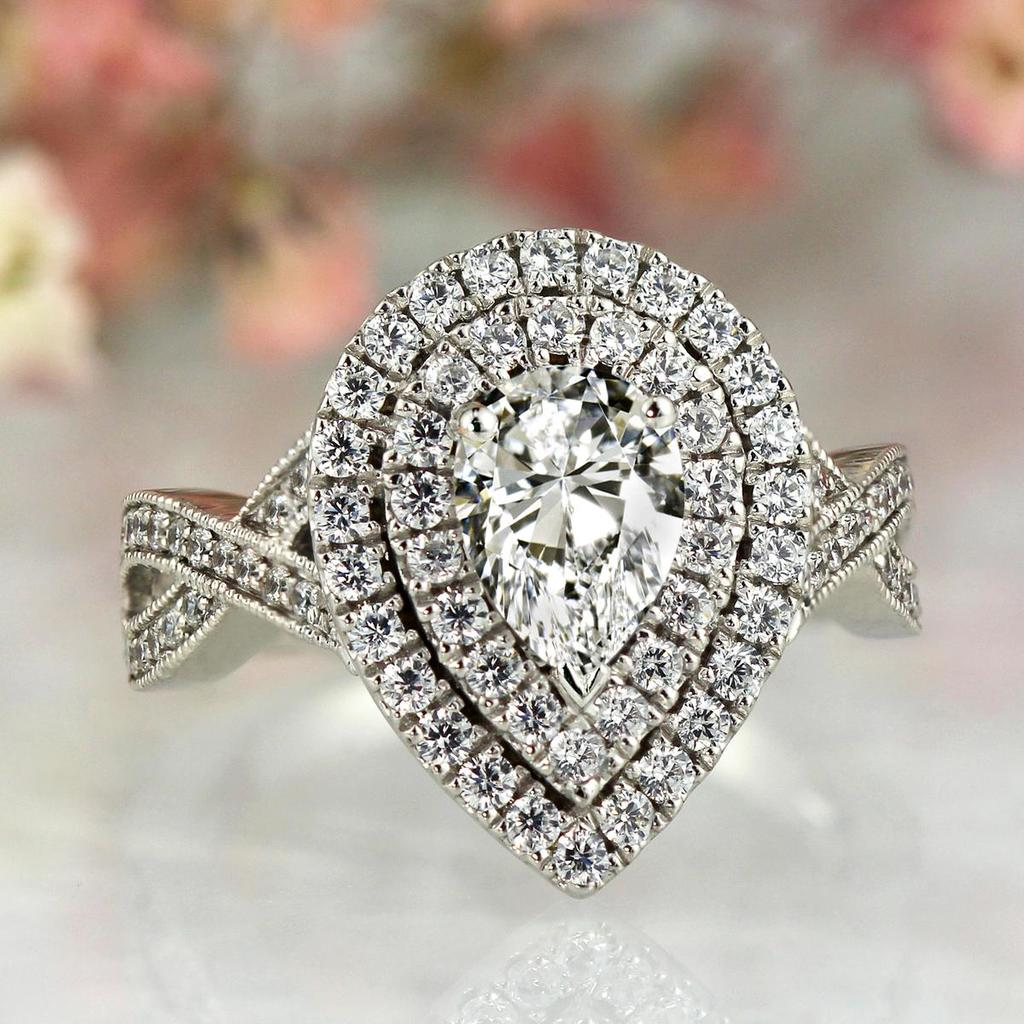 pear shaped halo engagement ring from Diamond Wish