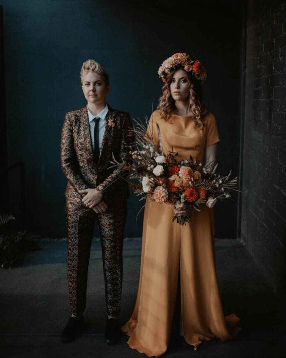 Halloween wedding mustard bridal gown with plaid suit