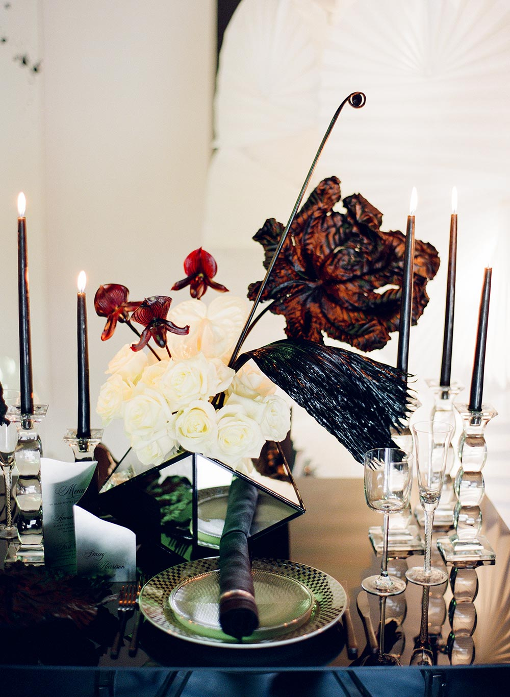 abstract wedding tablescape with burgundy and black hues