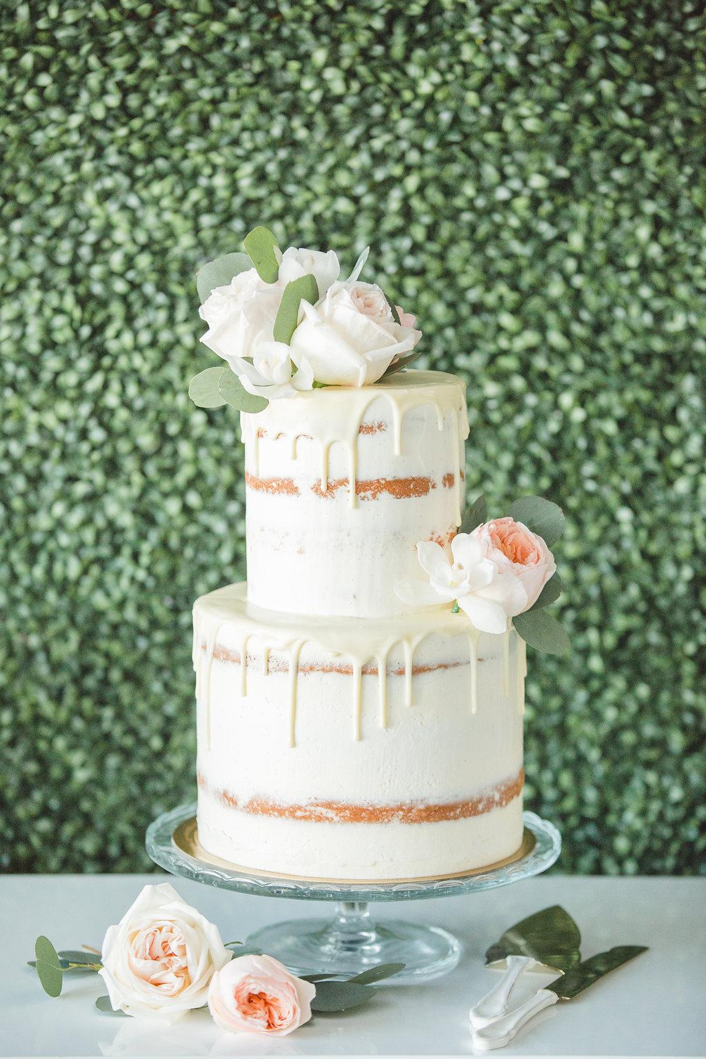 naked drip wedding cake - photo by Parrish House Photos http://ruffledblog.com/hawaiian-inspired-bridal-shower