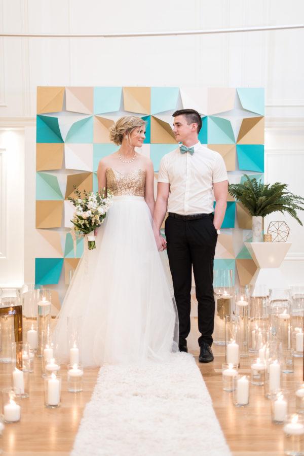 geometric paper ceremony backdrops - photo by Hayley Rae Photography http://ruffledblog.com/40-eye-catching-geometric-wedding-ideas