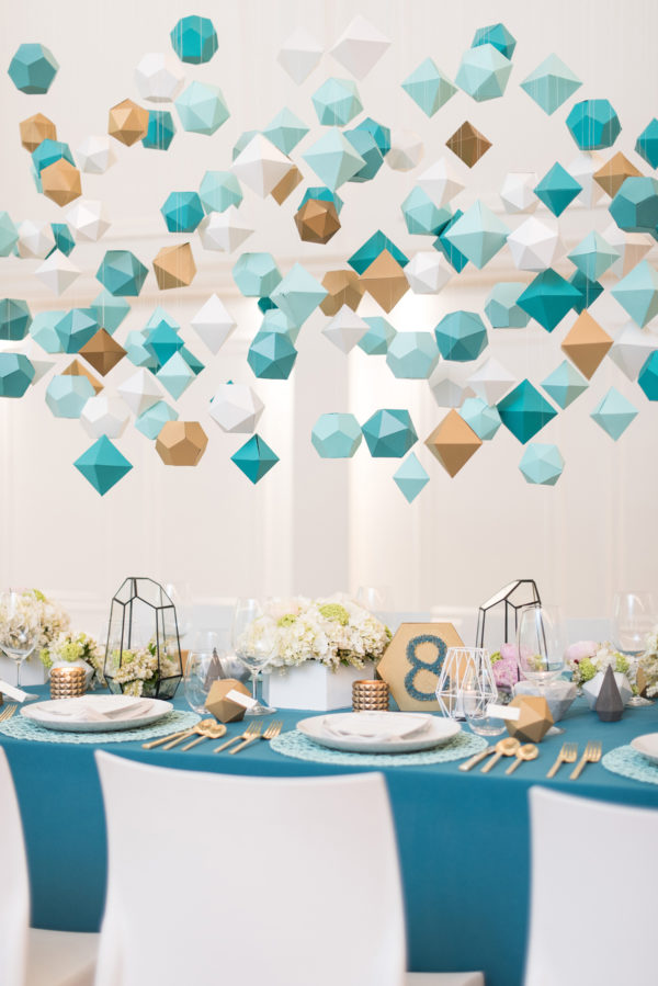 hanging geometric shapes - photo by Hayley Rae Photography http://ruffledblog.com/40-eye-catching-geometric-wedding-ideas
