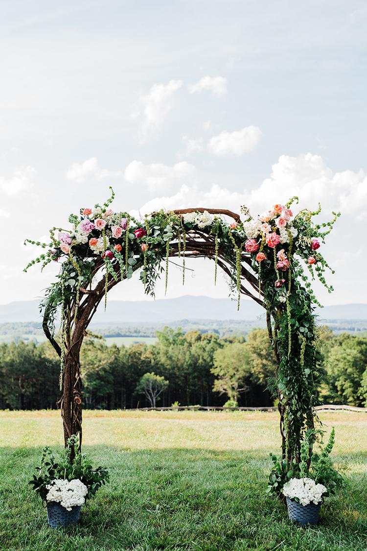 wedding ceremony arches with amaranthus - photo by Amilia Photography https://ruffledblog.com/heart-touching-north-carolina-nursery-wedding