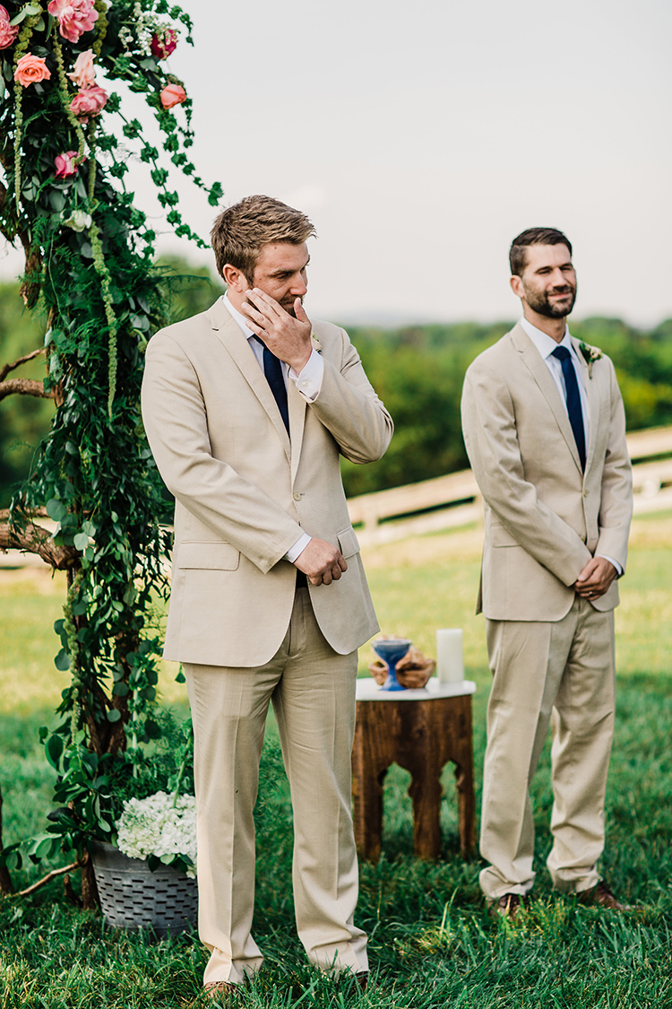 sweet groom reactions during the ceremony - photo by Amilia Photography http://ruffledblog.com/heart-touching-north-carolina-nursery-wedding