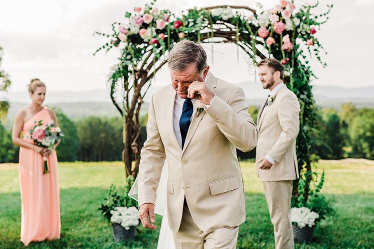 father of the bride reactions - photo by Amilia Photography https://ruffledblog.com/heart-touching-north-carolina-nursery-wedding